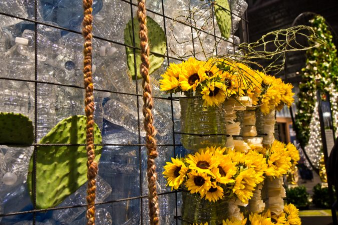 Sunflowers, corn husks and water bottles on display at the 2018 Flower Show. (Kimberly Paynter/WHYY)