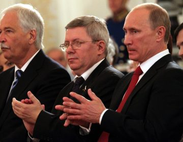Russian politician Alexander Torshin, standing next to then-Russian prime minister Vladimir Putin, attends a ceremony at the Kremlin in 2011. Torshin is a lifetime member of the National Rifle Association, and says he met Donald Trump through the group in 2015. (Konstantin Zavrazhin/Getty Images)