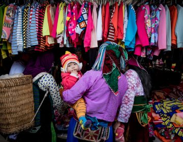 Shoppers explore the goods on display in Ha Giang, Vietnam. The country's textile industry was expected to be one of the biggest winners from the Trans-Pacific Partnership, which would have provided tariff-free access to U.S. markets. Under the new agreement, the industry is still expected to gain — if not nearly as much. (Linh Pham/Getty Images)