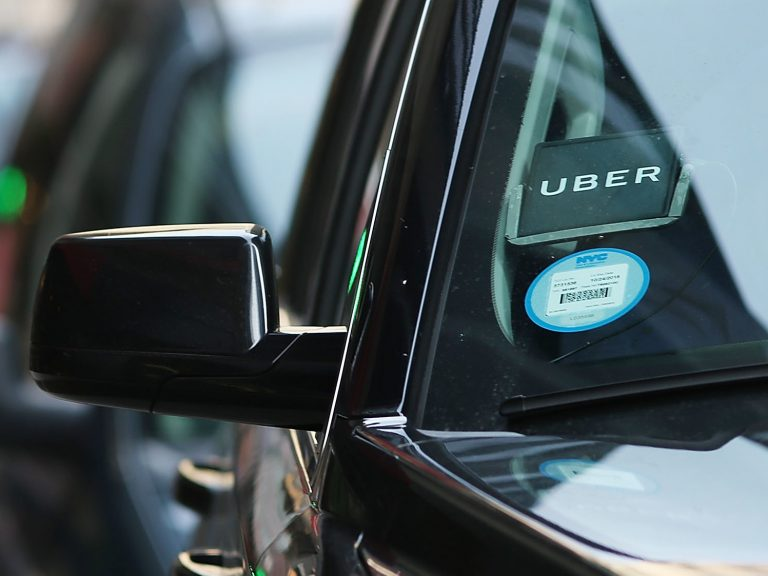 An Uber waits for a client in New York City. The company is partnering with health care organizations to provide patients with reliable transportation. (Spencer Platt/Getty Images)