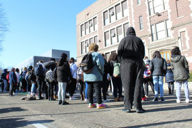 Students from Girard Academic Music Program in Philadelphia stand outside for 17 minutes of silence on March 14, 2018