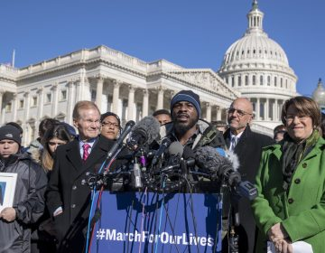 Robert Edwards, center, a student from Washington, speaks alongside lawmakers and gun control activists at the U.S. Capitol