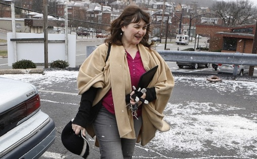 Shelagh Collins walks from her car to a job search appointment on Monday, Dec. 30, 2013, in Forest Hills, Pa., an eastern suburb of Pittsburgh. Collins gets by on occasional secretarial temp work and unemployment compensation checks, but she can't afford specialized treatment for her various health conditions that limit her ability to do certain jobs. (Keith Srakocic/AP Photo)