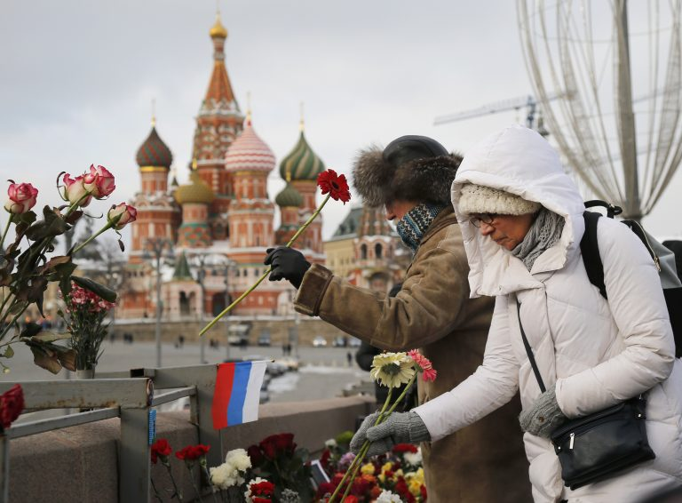 People lay flowers at the place where Russian opposition leader Boris Nemtsov was gunned down & Russia takes center stage : Radio Times : Politics u0026 Policy : WHYY