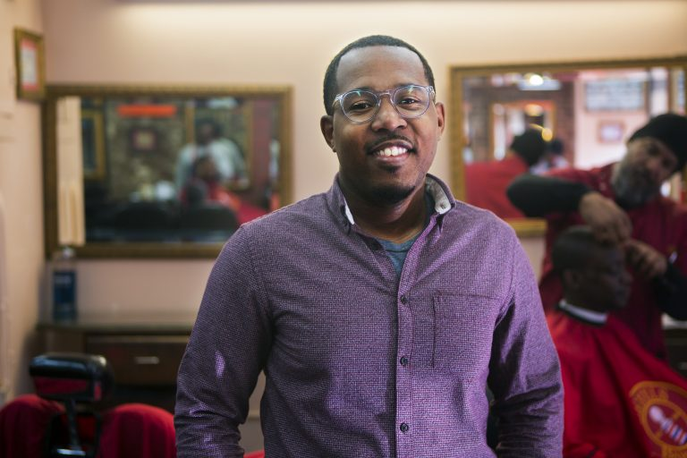Alvin Irby, founder of Barbershop Books, is on a mission to get kids reading in the barbershop. (Nickolai Hammer/NPR)