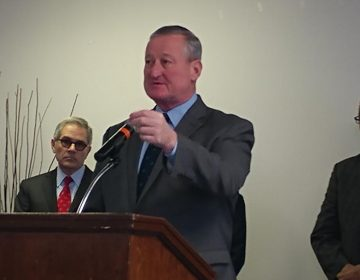 Philadelphia Mayor Jim Kenney announces the police-assisted diversion program Friday flanked by District Attorney Larry Krasner and Council President Darrell Clarke. (Tom MacDonald/ WHYY)