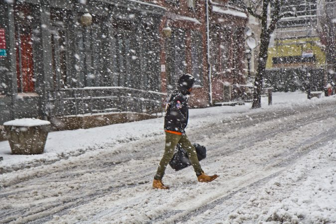 A pedestrian trudges through the storm in Philadelphia Wednesday afternoon. (Kimberly Paynter/WHYY)