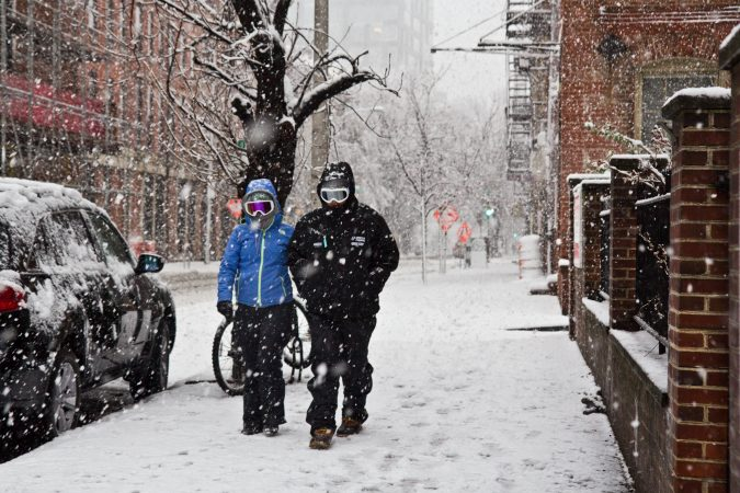 Pedestrian trudge through the storm in Philadelphia Wednesday afternoon. (Kimberly Paynter/WHYY)