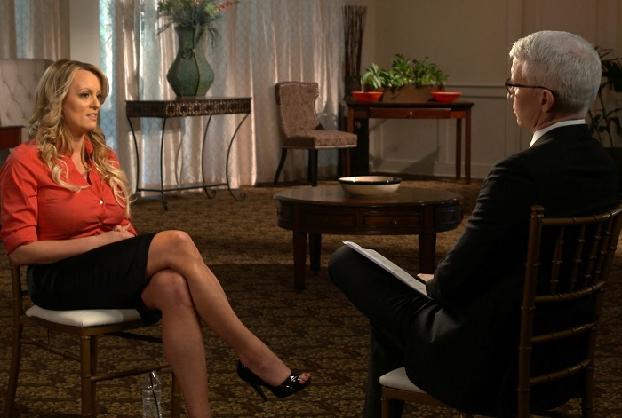 This image released by CBS News shows Stormy Daniels, left, during an interview with Anderson Cooper which will air on Sunday, March 25, on