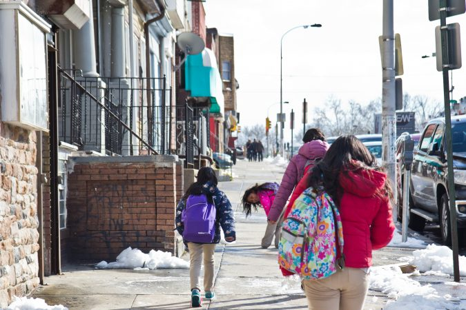 Students walk home after school on 5th Street in Olney. (Kimberly Paynter/WHYY)