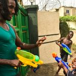 Gabriel Nyantakyi has a water fight with children in Accra Ghana in 2015. (Courtesy of Gabriel Nyantakyi)