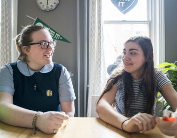 Seventeen-year-olds Maxine Van Osten, left, and Finn Kairer hang out after school in Philadelphia. Both girls have voluntarily reduced their time on their phones and social media. (Jessica Kourkounis for WHYY)