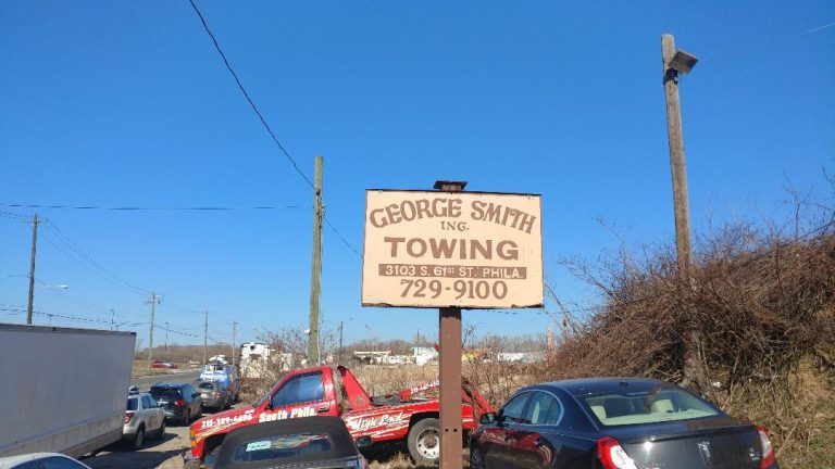 Sign outside George Smith Towing in Southwest Philadelphia (Tom MacDonald, WHYY)