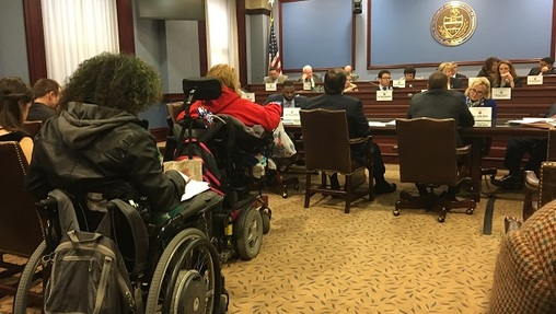 A number of protesters in wheelchairs attended the committee hearing on the bills to create new work requirements and other welfare restrictions. (Katie Meyer/WITF)