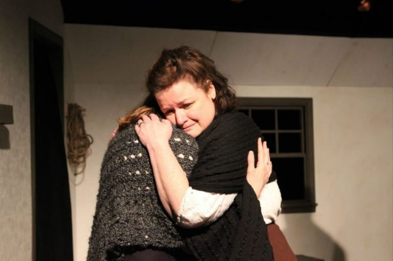 Mary Pat Walsh (shown) gives a hug to Katie Stahl in the Irish Heritage Theatre production of