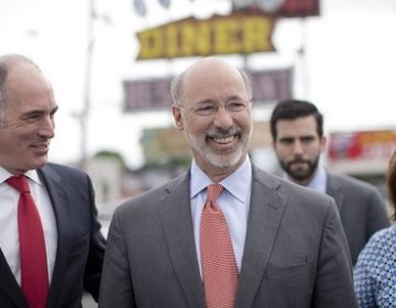Gov. Tom Wolf walks with Sen. Bob Casey outside of the Oregon Diner, Friday, May 23, 2014, in Philadelphia. (Matt Rourke/AP Photo, file)
