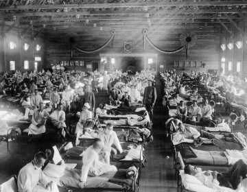 Patients at an Army ward in Kansas during the influenza epidemic of 1918. About 675,000 Americans died of the flu known as La Grippe. (NYPL/Science Source/Getty Images)
