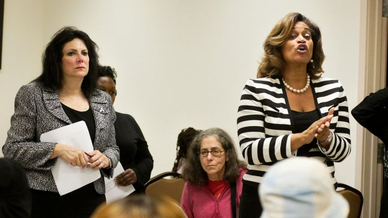 Karen Kolsky (left) and Evelyn Sample-Oates, two top central office staffers from the school district, explained Superintendent Hite's proposal at the 2015 community meeting. (Bastiaan Slabbers for WHYY)