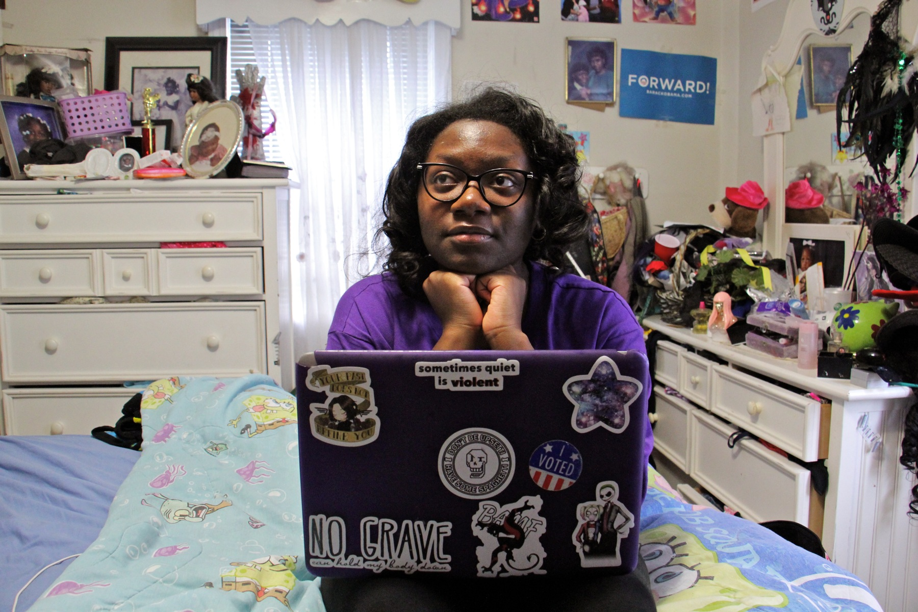 "High school junior Jayda Hepburn, sitting in her bedroom, wrote two librettos for ""Philadelphia Voices."" (Emma Lee/WHYY)"