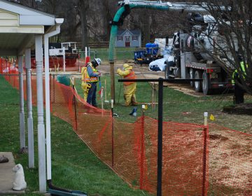 Pipeline workers probe the ground on Lisa Drive in West Whiteland Township where sinkholes have developed as a result of the Mariner East 2 construction. Vandalism to pipeline construction equipment nearby has garnered two separate $10,000 rewards. (Jon Hurdle/StateImpact Pennsylvania)