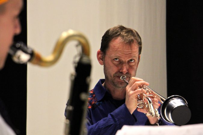 Marco Blaauw plays the trumpet and coaches the trio during a rehearsal for Schönheit (Beauty). (Emma Lee/WHYY)