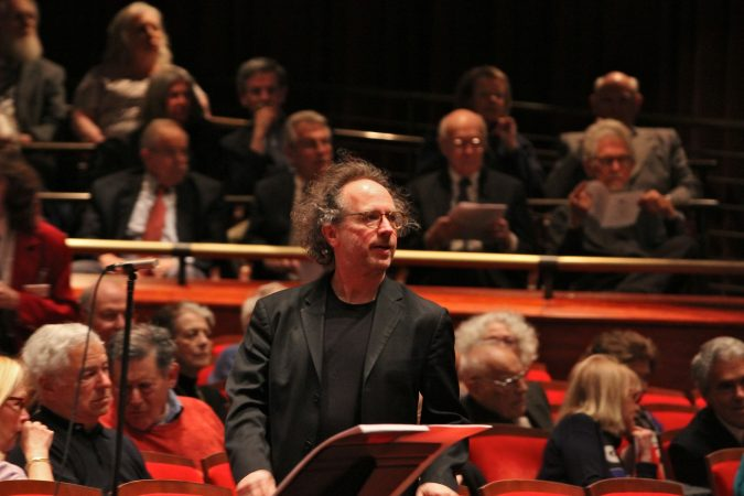 Composer Tod Machover watches a rehearsal of his crowd-sourced composition,