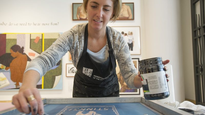 Alyssa Ebinger, an MFA student, prepares a silk screen for printing. (Jonathan Wilson for WHYY)