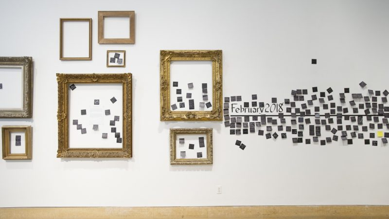 Post-It Notes on the gallery wall express vistiors' visions of the art world's futre. (Jonathan Wilson for WHYY)