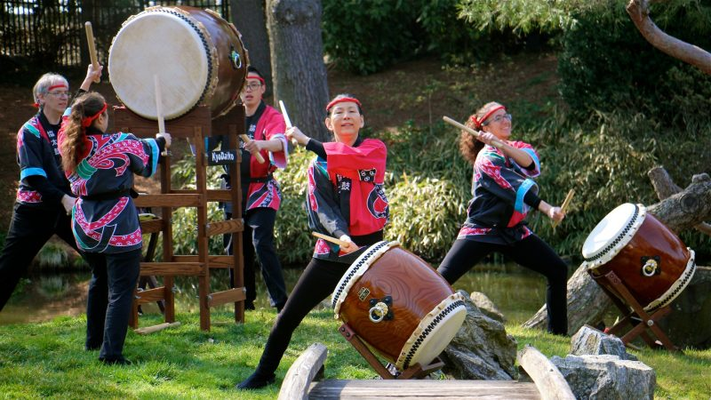 The Kyo Daiko drummers perform on the island at the Japanese House and Garden. (Emma Lee/WHYY)