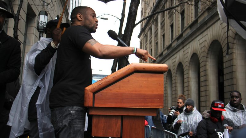 Temple professor Mark Lamont Hill calls for criminal justice reform during a rally for Meek Mill at the Criminal Justice Center. (Emma Lee/WHYY)