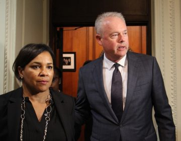 Starbucks chief executive officer Kevin Johnson and chief operating officer Rosalind Brewer emerge from a meeting with Philadelphia Mayor Jim Kenney that they said was