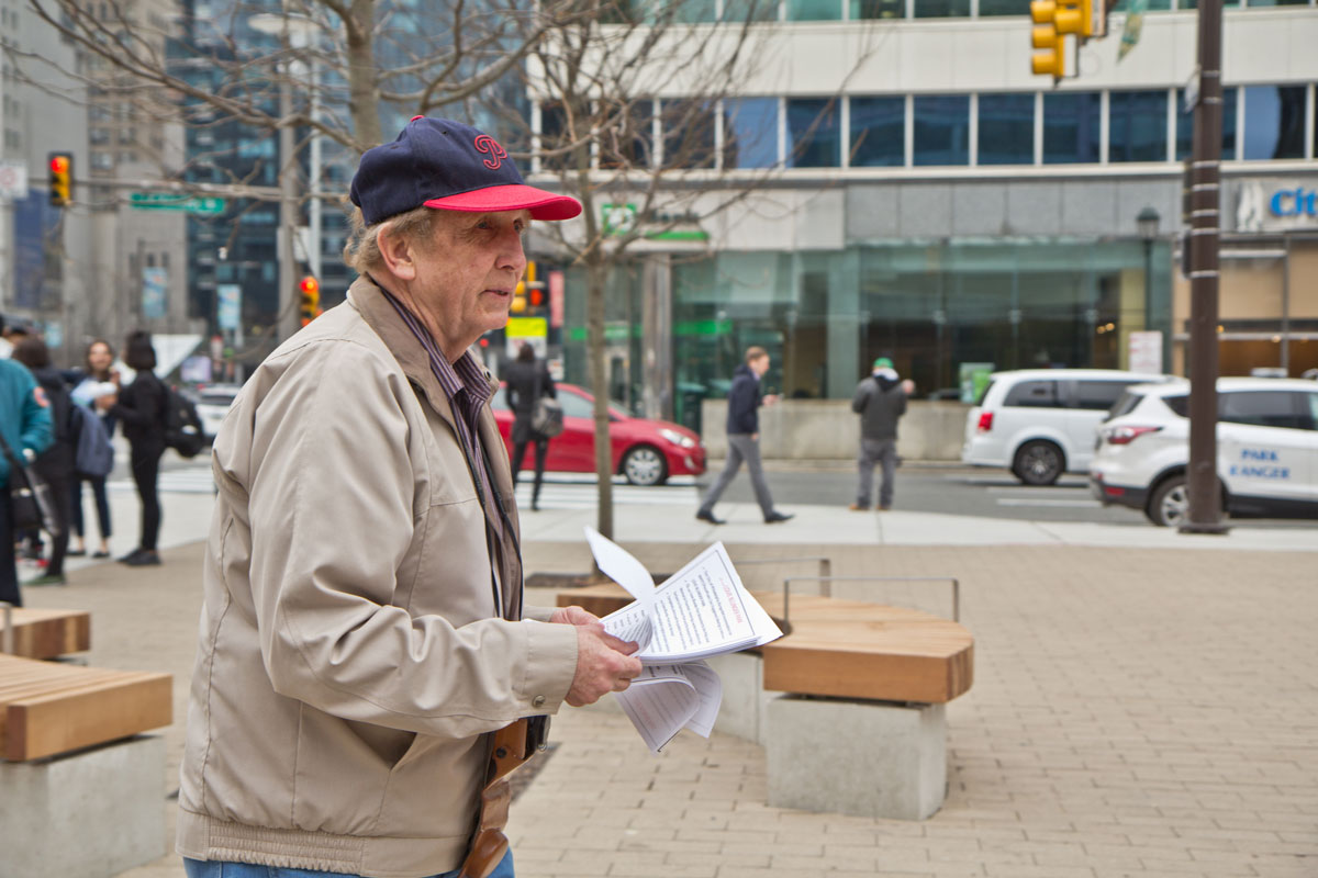 Steve Perzan, retired Philadelphia resident, hands out flyers with his Love Park criticisms.