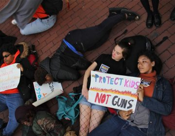 CAPA high school students (from right) Jordan Gibson and Alexandra Britton, participate in a die-in at City Hall, part of a national day of protest against gun violence on the 19th anniversary of the Columbine school shooting.