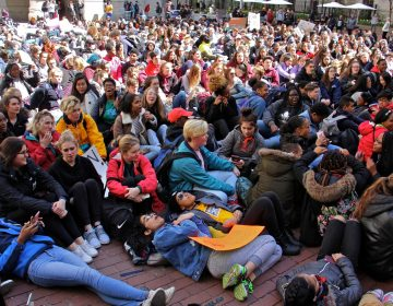 High school students lie down in the City Hall courtyard for a die-in, part of a national day of protest against gun violence on the 19th anniversary of the Columbine school shooting.
