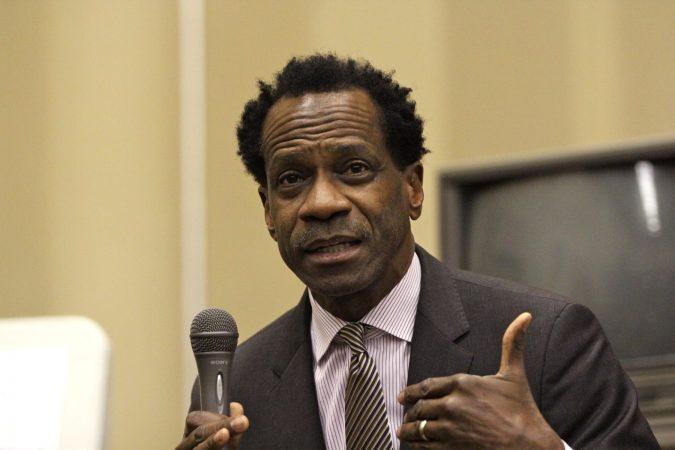 Philadelphia school board member Wayne Walker speaks at a community meeting at Dobbins High School. (Emma Lee/WHYY)