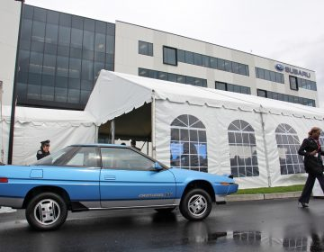 Subaru of America rolls out vintage cars to celebrate the grand opening of its headquarters in Camden.