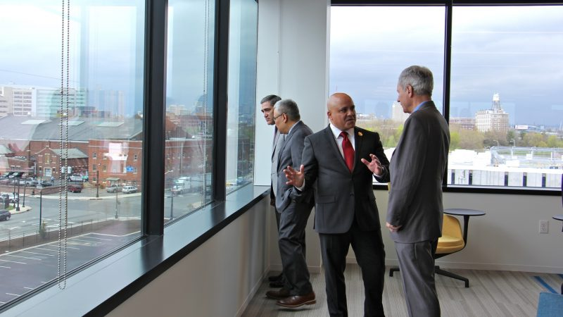 Subaru of America President Tom Doll (right) chats with Camden Mayor Frank Moran on the fifth floor of the new Subaru of America headquarters. (Emma Lee/WHYY)