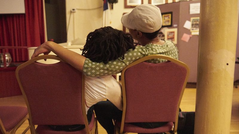 Audience members embrace during recordings of Martin Luther King Jr.'s speeches at Mother Bethel AME Church. (Natalie Piserchio for WHYY)