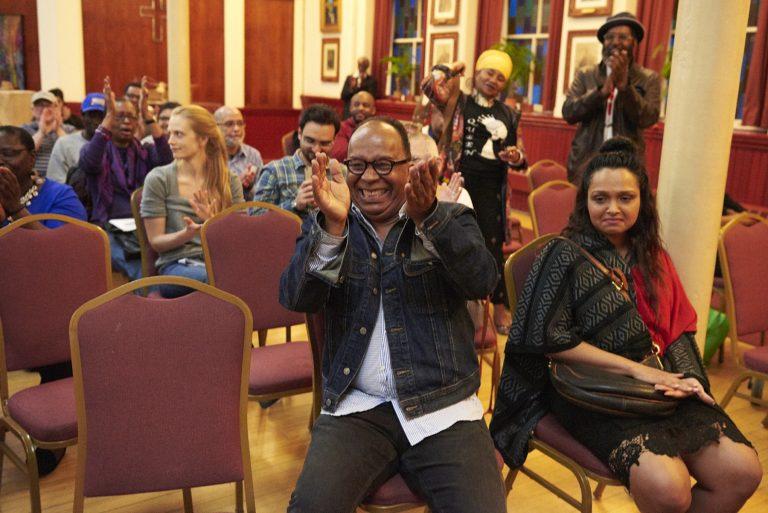 Dr. Tony Monteiro applauds during