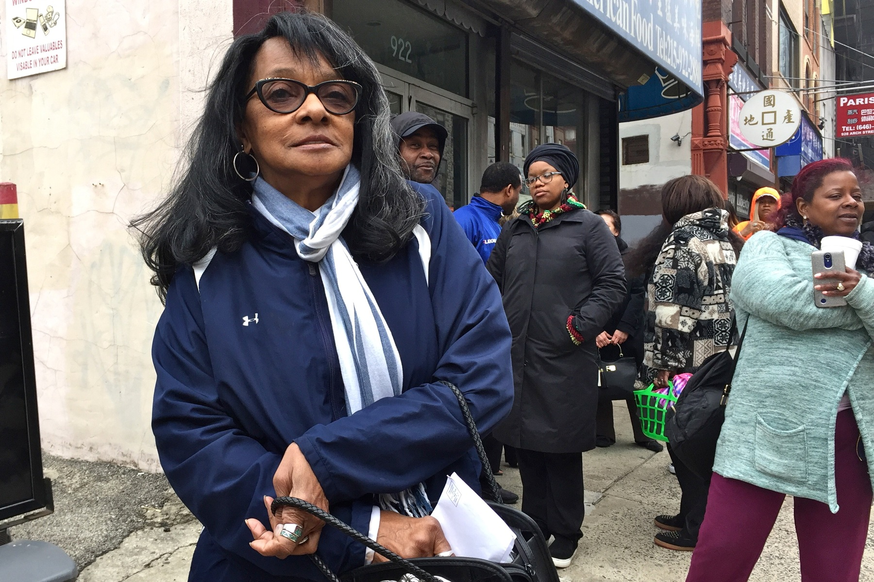 Joy Lipscomb waits in line to pay her parking tickets on the last day of amnesty.