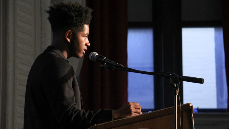 Student leader Ahmad Abdullah-Tucker makes an impassioned plea for community members to work together to end gun violence. (Emma Lee/WHYY)