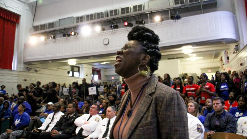 Dominique London weeps as she calls out the names of stuldents killed by gun violence during an assembly at Mastery Shoemaker charter school (Emma Lee/WHYY)