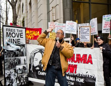 Zayid Muhammad leads a rally for the release of Mumia Abu-Jamal outside the Philadelphia Criminal Justice Center Monday morning. (Kimberly Paynter/WHYY)