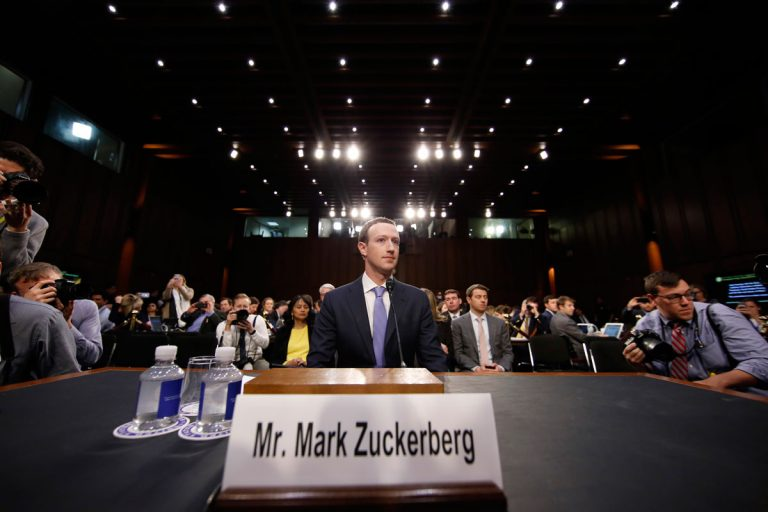 Facebook CEO Mark Zuckerberg takes his seat after a break to continue to testify before a joint hearing of the Commerce and Judiciary Committees on Capitol Hill in Washington, Tuesday, April 10, 2018, about the use of Facebook data to target American voters in the 2016 election. (AP Photo/Alex Brandon)