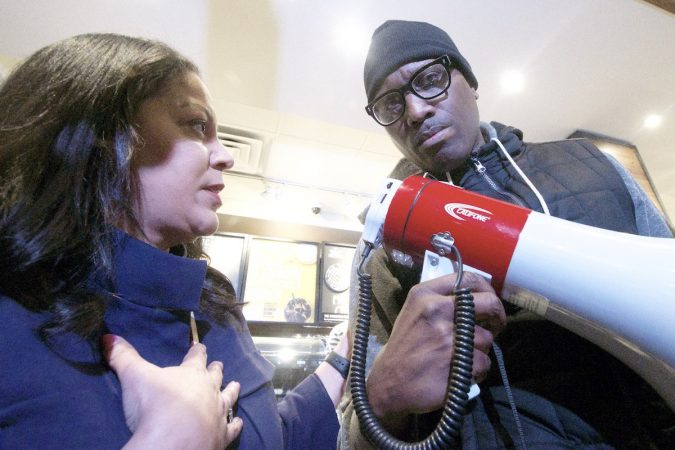 Camille Hymes, regional manager for Starbucks, speaks inside the coffee shop after hearing demands from the people gathered to protest Thursday's controversial arrest. (Bastiaan Slabbers for WHYY)