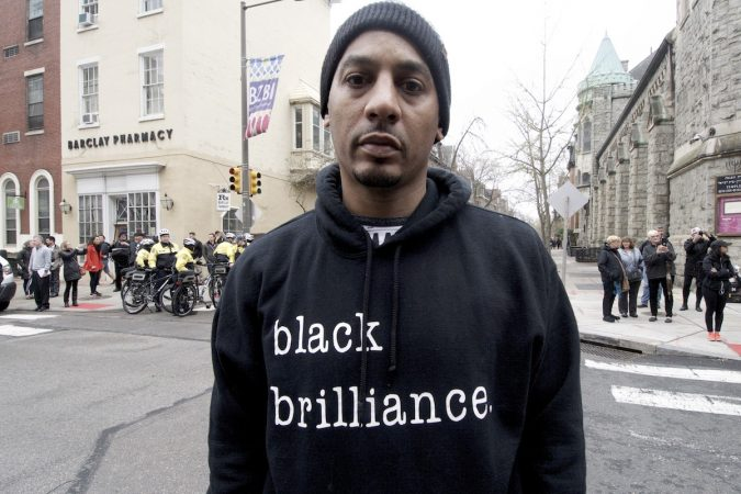 Edwin Santana is one of the people who gathered outside a Starbucks on 18th and Spruce streets in Philadelphia to protest Thursday's controversial arrests of two black men. (Bastiaan Slabbers/for WHYY)
