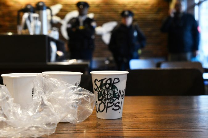An estimated 50 gathered inside the Starbucks near Rittenhouse Square on Monday morning to protest the recent arrest at that location. (Bastiaan Slabbers for WHYY)