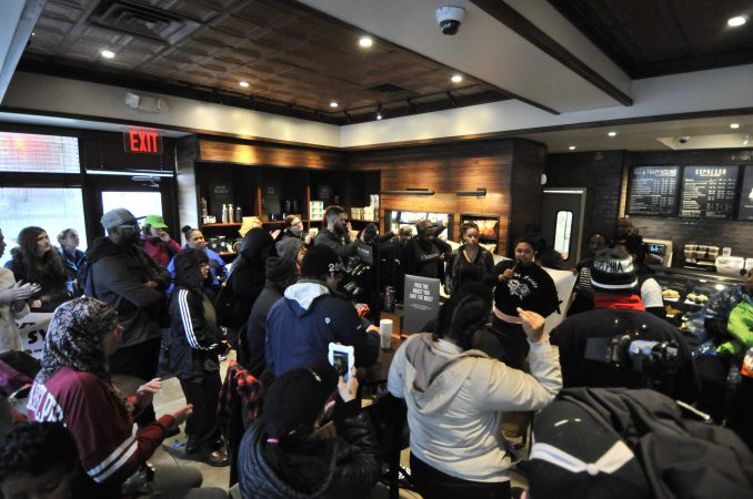 About 50 protesters gathered inside the Starbucks near Rittenhouse Square on Monday morning to protest the recent arrest at that location. (Bastiaan Slabbers for WHYY)