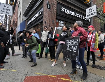 About 50 protesters gathered inside the Starbucks near Rittenhouse Square on Monday morning to protest the recent arrest of two black men. (Bastiaan Slabbers for WHYY)