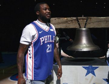 Rapper Meek Mill comes out to ring the ceremonial Liberty Bell replica before Tuesday's first-round NBA playoff game in Philadelphia Tuesday night. (Chris Szagola/AP)